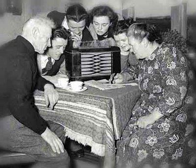 Stock Photo 1950s Family With 3 Children Watching Tv 12666412 together with 36 as well Radio 1920s in addition Entertainment in addition Stock Photo 1930s Father Reading To Family In Chair 31560040. on old fashioned families gathered around radio